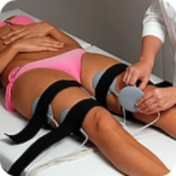 Electronic Muscle Stimulation Pads on Legs
