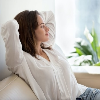 relaxed lady with hands behind head